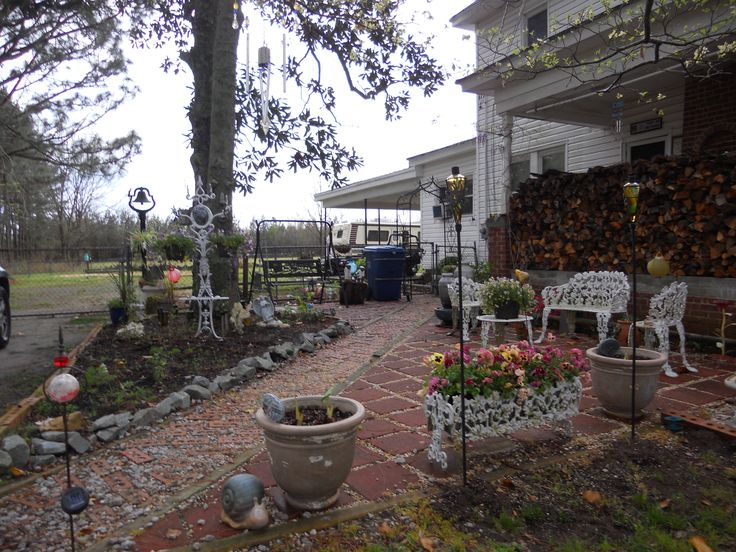 We have been remodeling our home and its landscaping.  The home was built in 1918 by my Grandmother's brothers for her as a wedding gift.  This American Farm House holds thousands of old memories and a host of new ones.