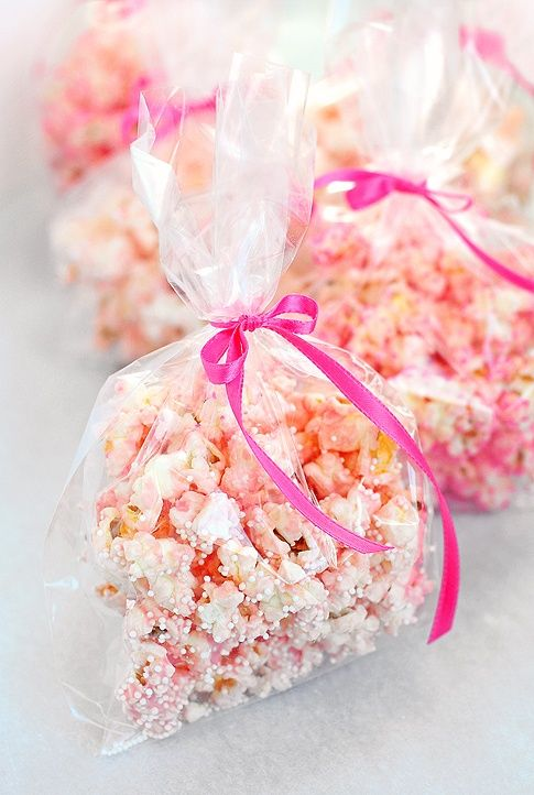 Party popcorn- add sprinkles when freshly popped and toss popcorn in bag. Separate into smaller bags.