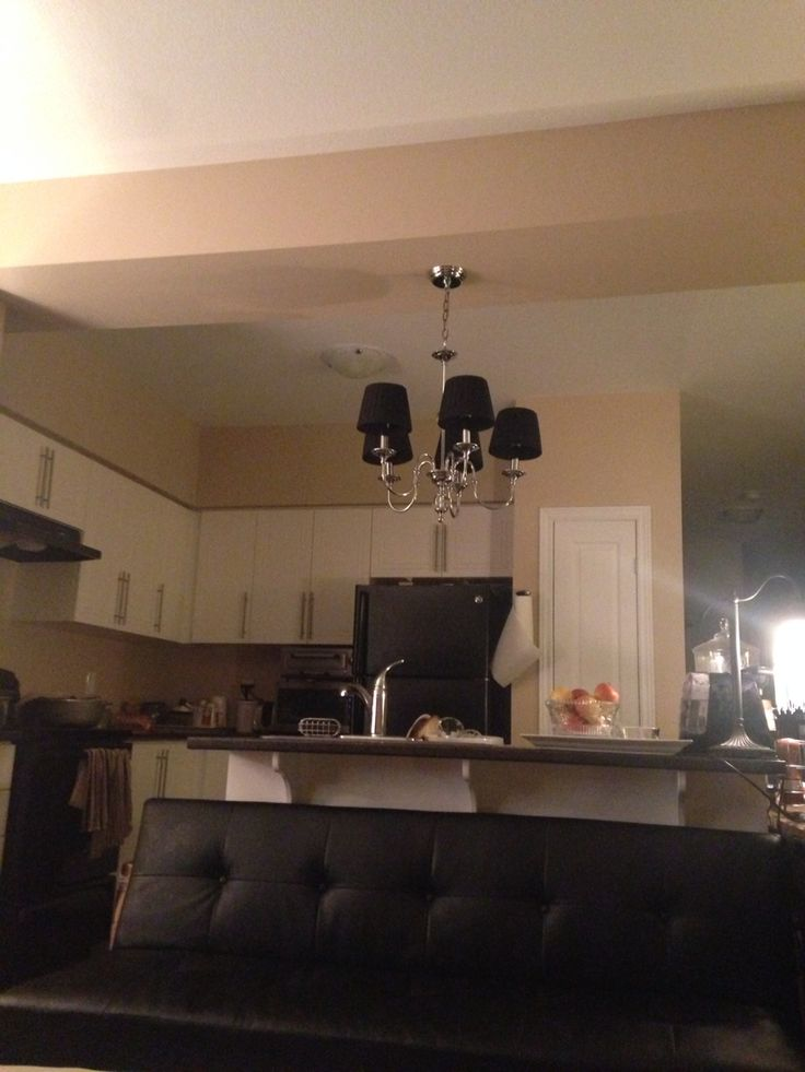 Placing ceiling light fixture in between 2 adjoining rooms.