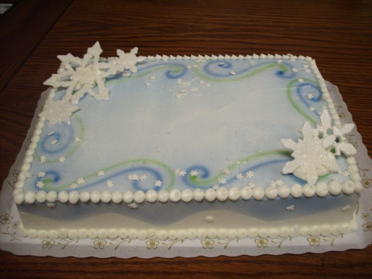 This is just a simple sheet cake design that I like to do up for the winter season.   Airbrushed with fondant snowflakes,  snowflake quins a...
