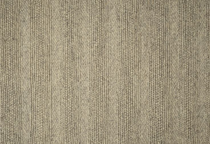 Like a thick Irish knit, this rug is woven from raw wool, without any dye or chemical treatment.