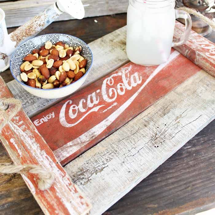 Make this DIY tray from an old Coke crate and add it to your rustic farmhouse style home. This is perfect for entertaining or just using as home decor!