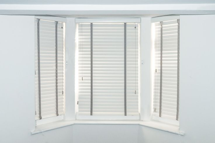 Chalk wood venetians with estate grey tapes in bay window. http://www.theblindshop.com