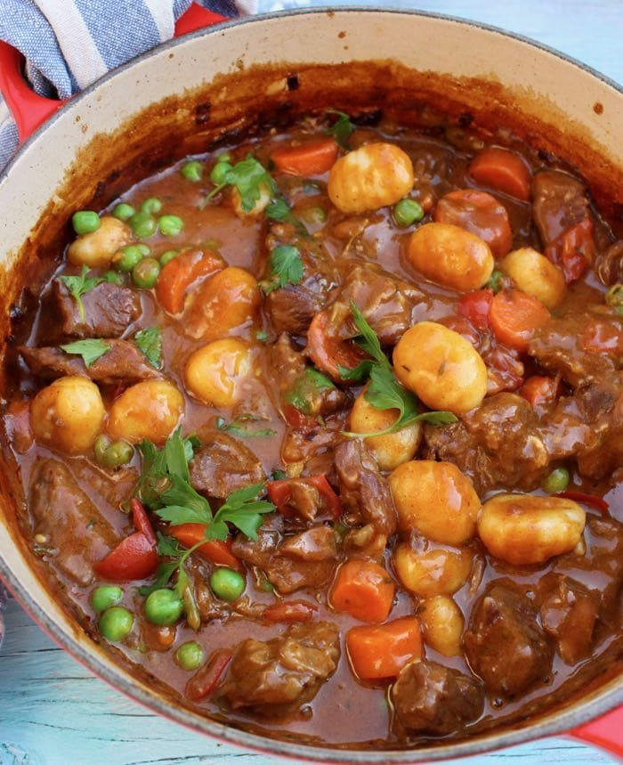 An easy and hearty homemade beef stew made with fork tender grass fed chuck roast beef, in a smoky paprika gravy with subtle hints of clove.