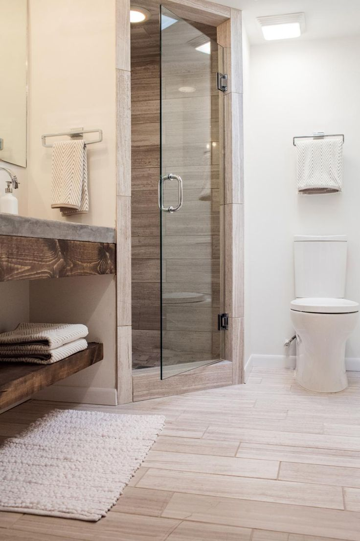 Removal of the tub, carefully thought out use of space and a lighter earth-toned palette makes the small master bath feel much larger.