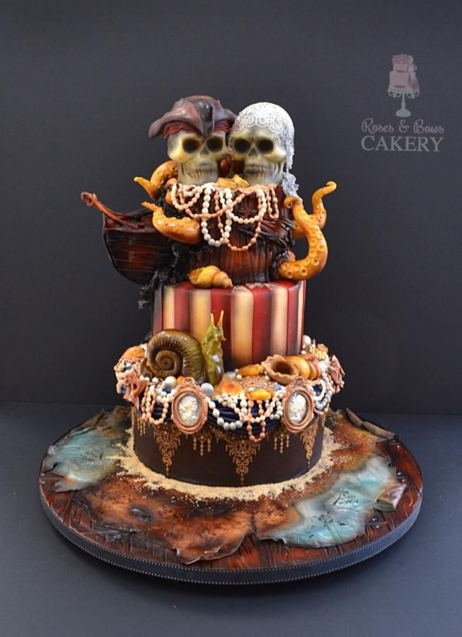 My Fave Tiered Pirate Cake Ever - by Karen Keaney of Bows & Roses Cakery - http://cakesdecor.com/cakes/121979-dead-pirates-wedding-cake