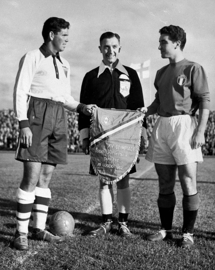Harry Keough, left, captain of the U.S. Olympic men's soccer team, greets Italy's captain, E. Pandolfini, right, and referee A.E. Ellis prior to the start of their match in Tampere, Finland. Keough, who played for the U.S. soccer team that famously upset England at the 1950 World Cup, died Tuesday at his home in St. Louis. He was 84.