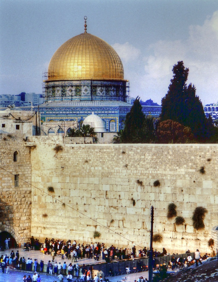 The Western Wall, Old City of Jerusalem. Dome of the Rock was erected by the Muslim ruler Abd el-Malik in 688-691 - Jerusalem, Israel