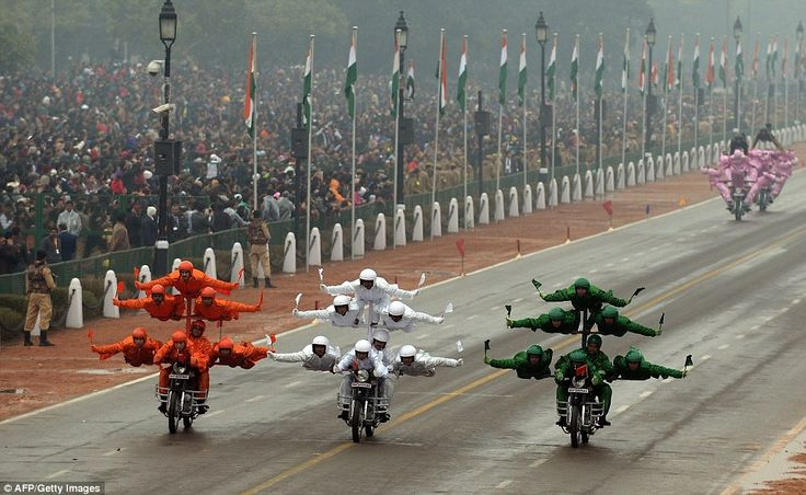 Indian Border Security Force motorcycle specialists performing in the rain during the Republic Day parade