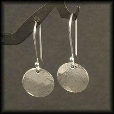 These small textured Dangling Solid Silver Earrings are fabricated from sterling silver sheet and wire. The round is a half inch in diameter and the earring will fall 1.25 inches from your piercing. A timeless design perfect for any age making these hammered sterling silver dangle earrings a great gift choice. Handmade by me especially for you in my studio.  NOW AVAILABLE in 14K Rose Gold Fill and 14K Yellow Gold Fill - please see variations. Thanks for stopping by and please come again…