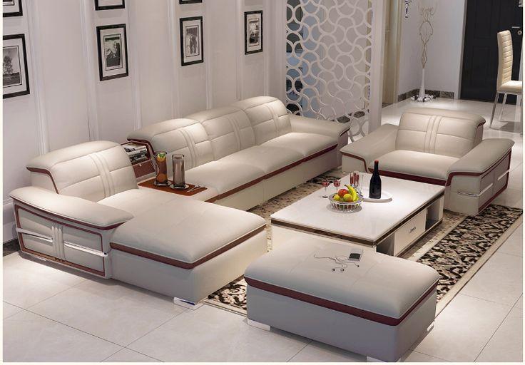 Большой модульный диван с красным обрамлением и дополнительными подставками и полками в комплекте с креслом и пуфом в интерьере гостиной в стиле хай-тек можно купить https://lafred.ru/catalog/catalog/detail/42689862607/