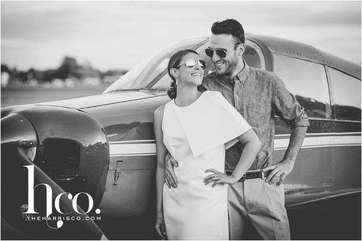 Romantic engagement shoot | drama | movie star glam engagement shoot | chic white dress| black and white engagement session| sexy engagement session photos | Albany International Airport engagement session| plane engagement pics| photo by makayla jade of the harris company
