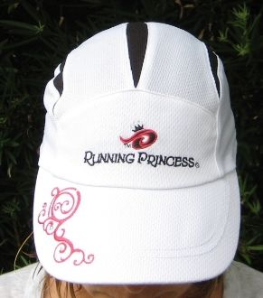This Running Princess racing hat is 100% CoolMax® Polyester Fabric for wrap around wicking. This white and black hat features the Running Princess name and logo on the front panel with clear rhinestones above the tiara, contrasting pink scroll work on the bill with rhinestones as well and logo with rhinestones on the back. 100% machine washable. Adjustable back closure. Light weight comfort at 1.5 ounces. We recommend using sunscreen for maximum protection.