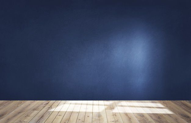 Download Dark Blue Wall In An Empty Room With A Wooden Floor For