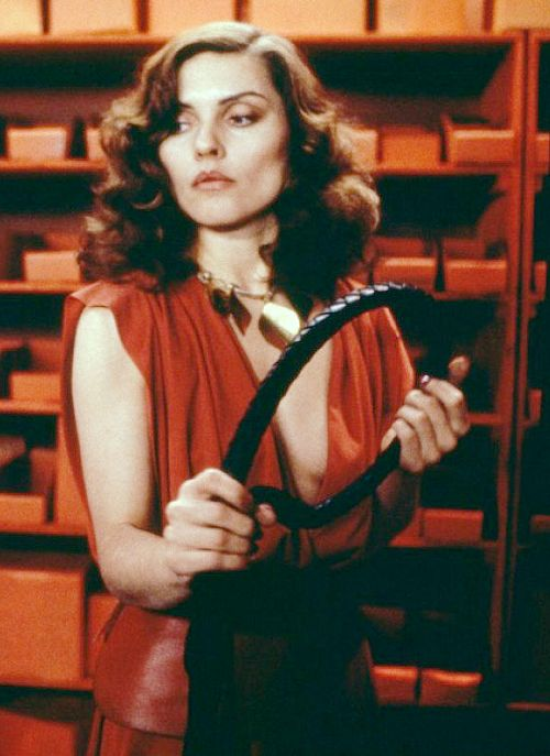 """Debbie Harry with a whip in """"Videodrome"""" (1983)"""