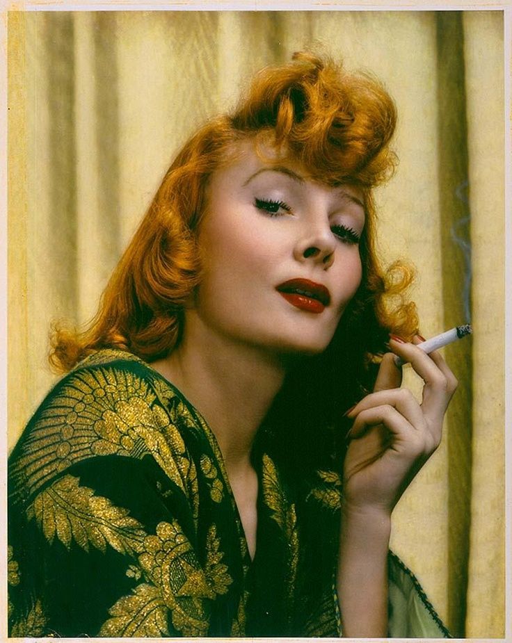 Red Haired woman by photographer Paul Outerbridge, 1940s.