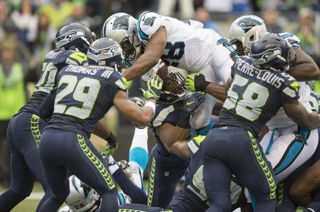 Oct 18, 2015; Seattle, WA, USA; Carolina Panthers running back Jonathan Stewart (28) scores a touchdown during the second half against the Seattle Seahawks at CenturyLink Field. The Panthers won 27-23. Mandatory Credit: Troy Wayrynen-USA TODAY Sports