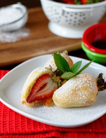 deep fried strawberries. who would have thought of it? with chocolate sauce for dipping. i'm in :) @Stephanie Rutan Ummm. can you say good use of the deep fryer you got today?!?!?