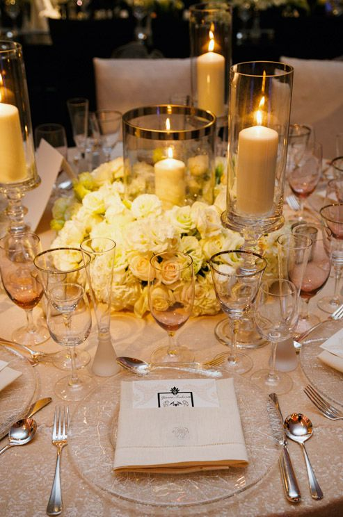Hurricane candle and white roses as centerpiece wedding