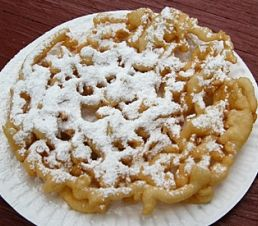 Funnel Cake:  1 egg  2/3 c milk  2 Tbs sugar  1 1/4 c flour  1/4 tsp salt  1 tsp baking powder:    1.Heat oil in skillet.  2. Beat egg & milk. Mix all other ingredients in a separate bowl & slowly add to the egg mixture.  3. Using a funnel, drop into hot oil working from center outwards in a web pattern.    4. Cook for about 2-3 minutes, remove from the oil when golden brown and crispy.  5. Sprinkle with powdered sugar.