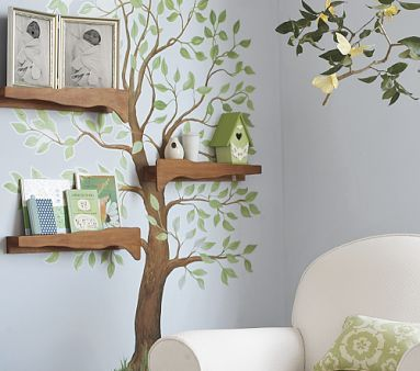 painted tree on wall with little shelves- cute for a babies/childs room!