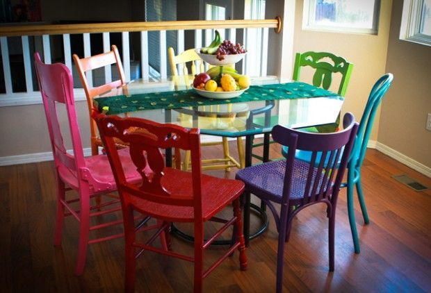 I love all of these thrift store chairs painted different colours for this dining area.: