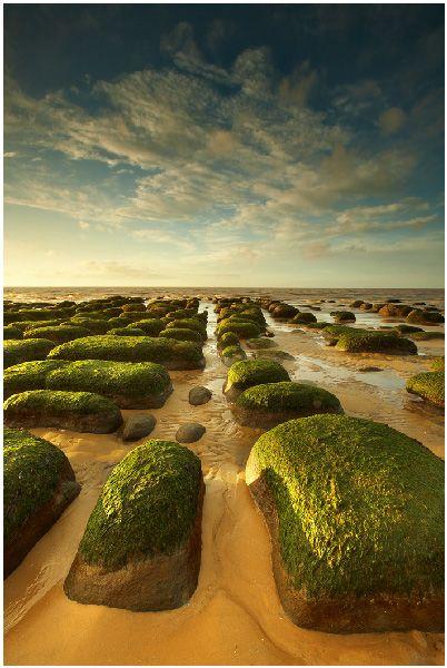 hopping across stones at Hunstanton beach, Norfolk