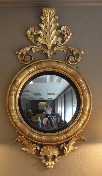 """Late Regency giltwood and ebonised convex mirror of large size Ca1820 England. 59""""H x 32.5""""W."""