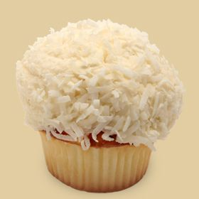 Coconut Blitz: Our moist Coconut Cake, with our Buttercream Frosting and piled high with Shredded Coconut.