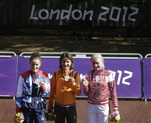 London Olympics Cycling Women  July 29Marianne Vos, center, of The Netherlands, poses for photographs with Elizabeth Armitstead, of Great Britain, left, and Olga Zabelinskaya, right, of Russia, after winning the Women's Road Cycling race at the 2012 Summer Olympics, Sunday, July 29, 2012, in London. (AP Photo/Sergey Ponomarev