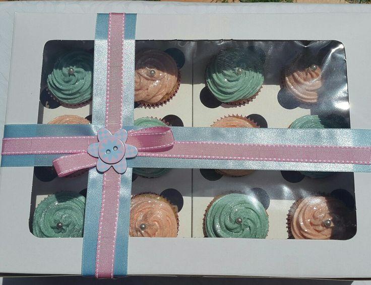 A boxful of vanilla cupcakes