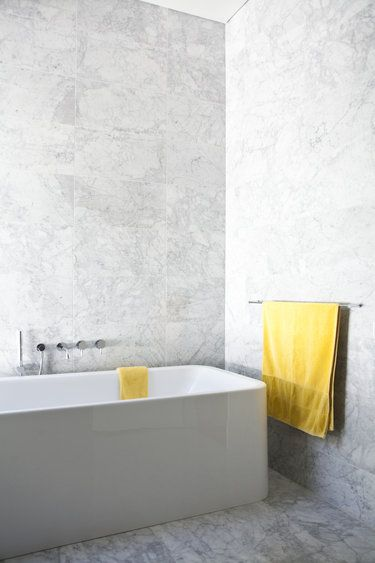A simple way to add a pop of bright yellow to complement this elegant, minimalist style in a Hazelwood Park Residence bathroom in South Australia, designed by Genesin Studio, who recently received the Emerging Practice Award at the 2013 Australian Interior Design Awards.