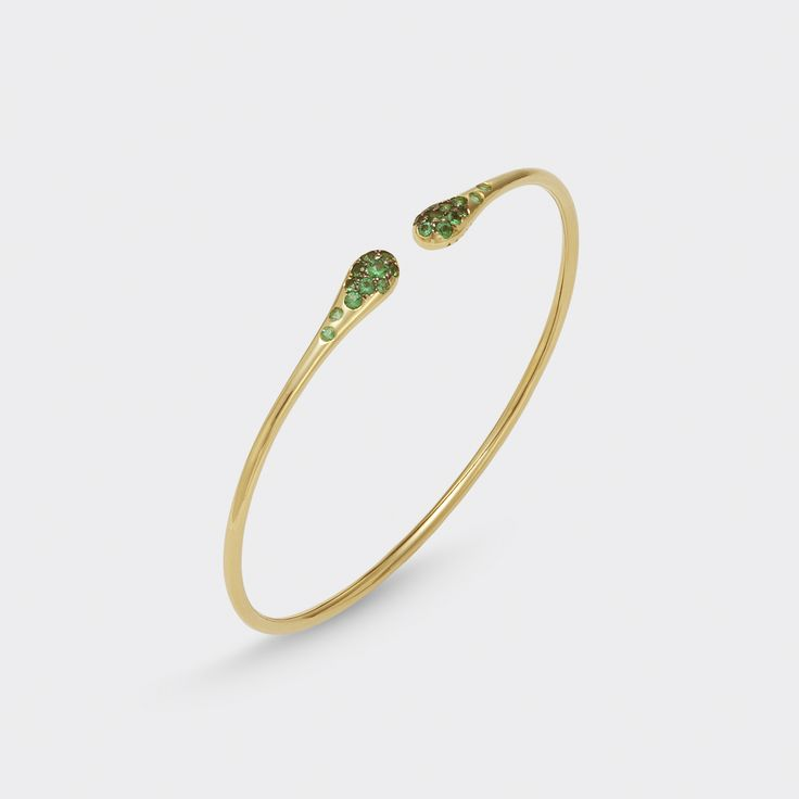 bracelet in  18 kt Yellow gold with diamonds and emeralds
