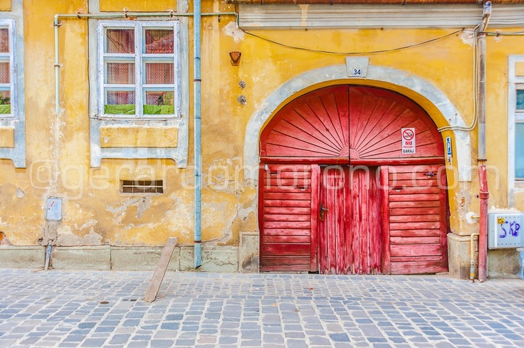 Urban Photography - The colorful and old streets of Braşov, România (doors & windows porn)  See more at www.facebook.com/octolite