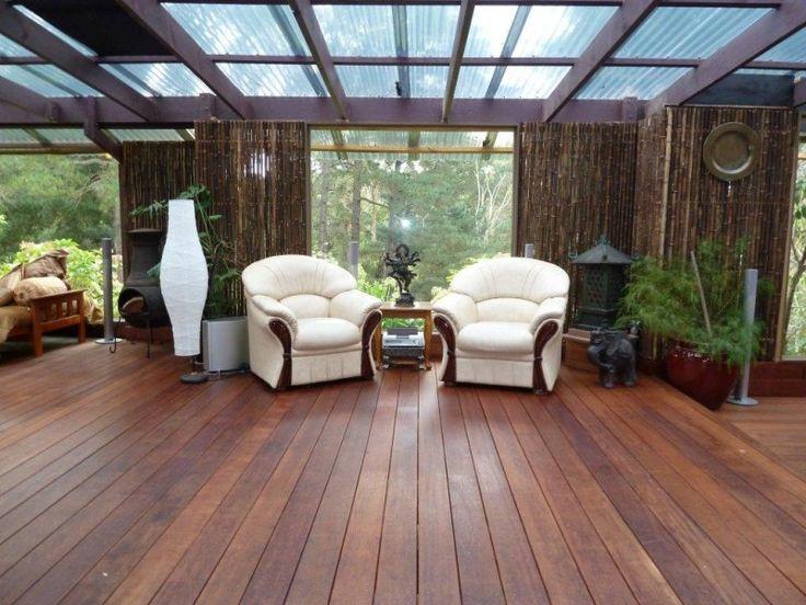 Indoor-outdoor outdoor living design with deck & decorative lighting using glass - Outdoor Living Photo 190062