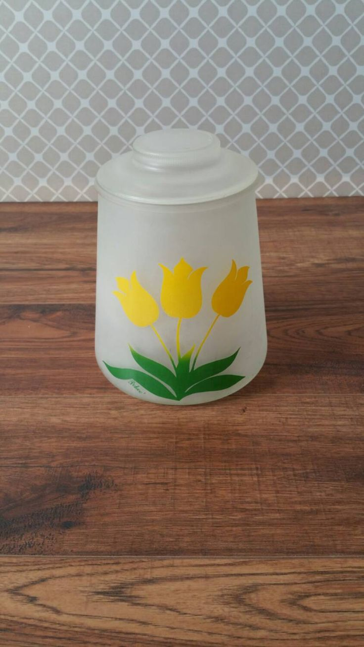 Glass cookie jar with lid. This canister has frosted glass with painted tulips and green leaves. It does have a few smudges I couldnt get out, you can see them in the pictures. It does not have any cracks and is in great shape for its age.  Dimension: 8 1/4 tall x 6 3/4 wide