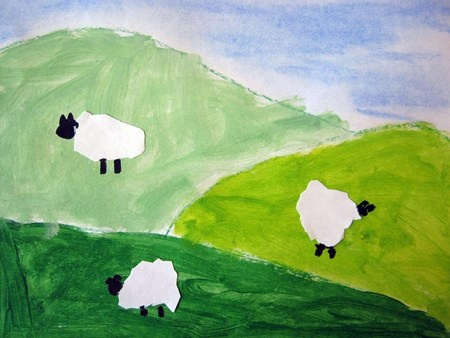 Tints and Shades with Sheep. As part of our global studies, the Second Grade painted these lovely landscapes that depict the hills of Ireland. The fun of this project was exploring color mixing as we painted dark, medium, and light shades of green. We also learned the terms foreground, middleground and background. The details of the sky and the sheep were added the following week.