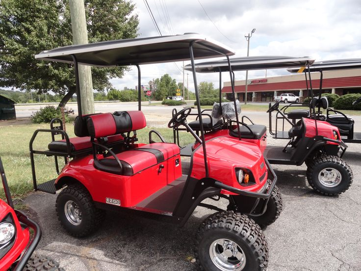 2016 E-Z-GO S-4 GAS GOLF CART FLAME RED BODY  SEATS ARE BLACK/ RED  REAR FLIP SEAT (RED/ BLACK HEAD TAIL AND BRAKE LIGHTS 80 INCH BLACK TOP SPLIT WINDSHIELD COME BY OR CALL TODAY   678-245-2995 *AUTHORIZED E-Z-GO DEALER HAPPY'S CUSTOM GOLF CARTS 434 OLD MILL PLACE CARTERSVILLE,GEORGIA 30120