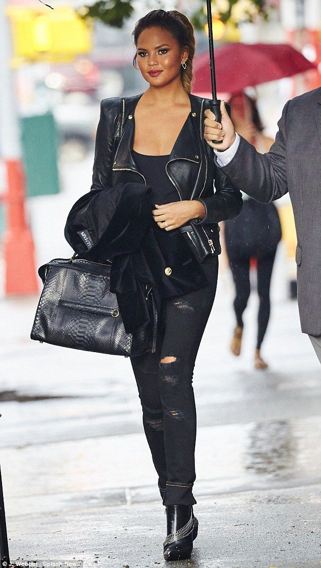 Rock on: Chrissy Teigen seemed ready to headbang in head-to-toe black that included a leather motorcycle jacket, ripped jeans and boots with chains on them as she stepped out in NYC on Thursday