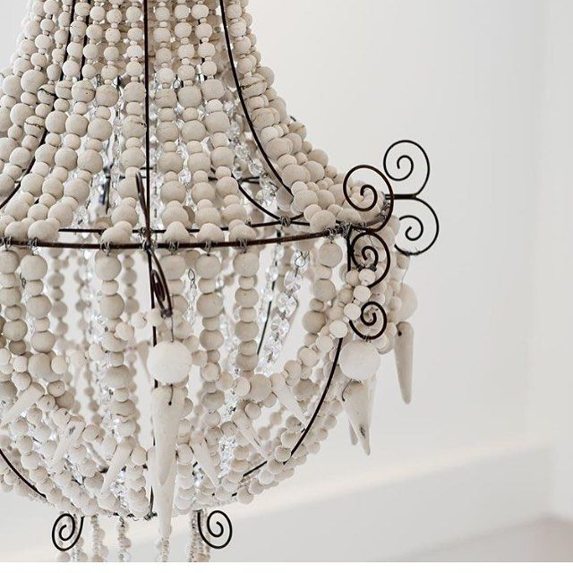 We're still in love with this chandelier from @african_trading_port which we hung over the void in House 3 (sans globe )…