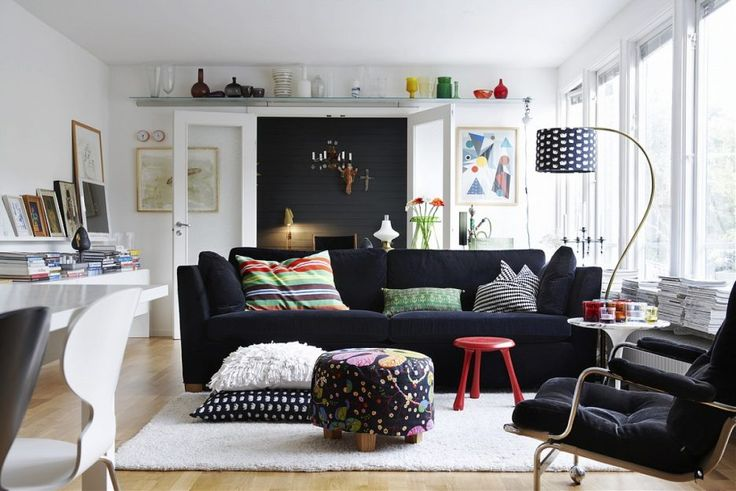 Living Room. 26 Scandinavian Style Living Room Designs. Small White Scandinavian Style Living Room with Elegant Black Fabric Sofa Furniture that have Pillows on the Seat Cushions also Unique High Style Floor Lamp also Rectangle Shaped White Rug on the Wood Flooring