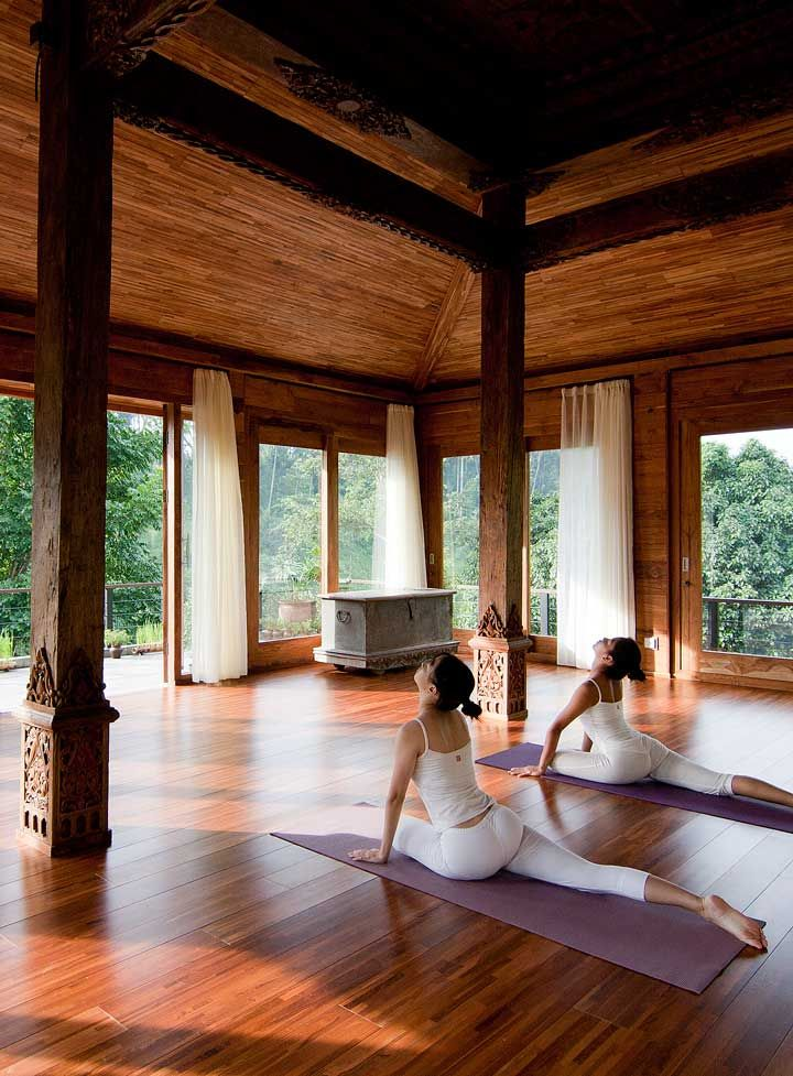 Greet the rising sun with a Kundalini yoga session inside a 100 year-old Indonesian joglo hut, surrounded by the rainforest. #Indistay | Kamandalu Ubud Resort & Spa, Bali