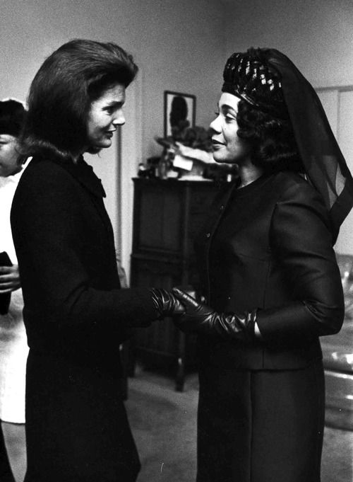 Jackie Kennedy gives her condolences to Coretta Scott King at the funeral of her husband, Martin Luther King, 1968.