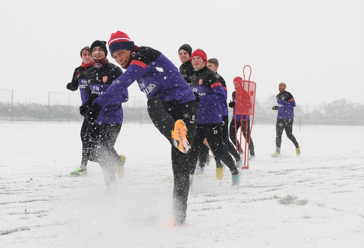 Arsenal squad with Thierry Henry during a snowy training session at London Colney (January 2013) by Stuart MacFarlane