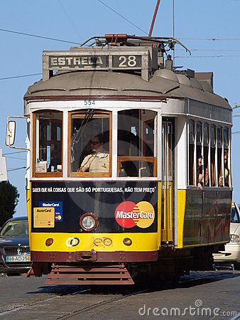 LISBON, PORTUGAL - AUGUST 11: Traditional yellow and red trams downtown Lisbon on August 11, 2009. Trams are used by everyone and also keep the traditional style of the historic center of Lisbon.