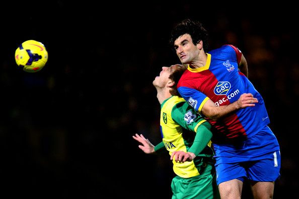 NORWICH, ENGLAND - NOVEMBER 30: Luciano Becchio of Norwich and Mile Jedinak of Palace compete for a header during the Barclays Premier league match between Norwich City and Crystal Palace at Carrow Road on November 30, 2013 in Norwich, England. (Photo by Jamie McDonald/Getty Images)