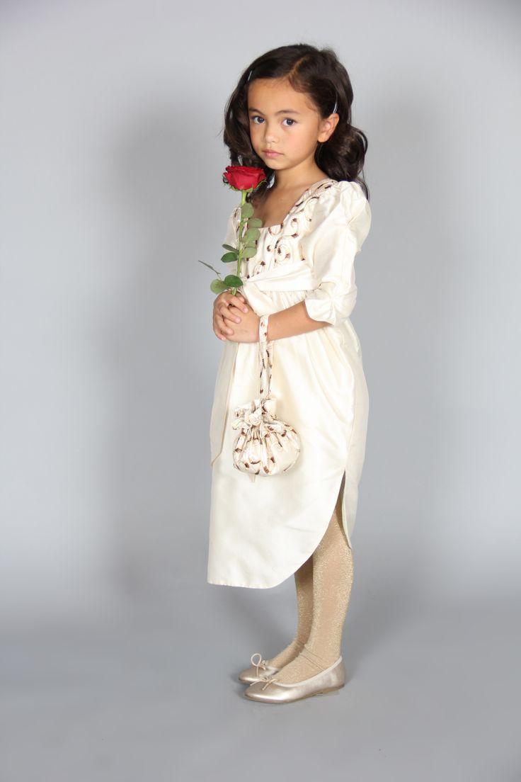 Genevieve dress - Silk taffeta dress with a bow sash with tulip layered skirt.