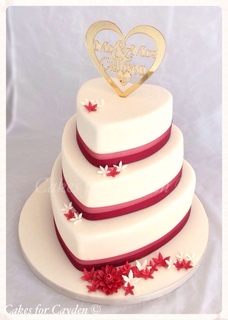 Ivory &  burgundy heart shape wedding cake with scattered flowers