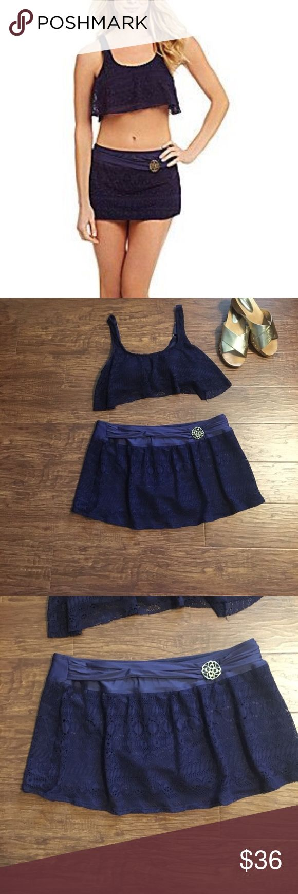"""Antonio Melani 2 piece navy bathing suit Gorgeous two-piece navy blue bathing suit by Antonio Melani. Size large. Like new. Excellent preowned condition no flaws stains or rips's. Top has an adjustable strap and padded bra in the bottoms are in excellent condition as well with a skirt style design.            MEASUREMENTS LAYING FLAT:               SKIRT: waist: 17"""" length: 11.5"""" TOP: armpit to armpit is 15.5""""across the bottom Band measures 14""""…"""