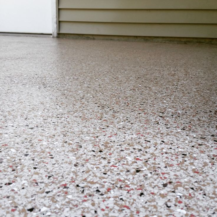 Concrete Patio Coated With A Polyurea Full Chip System